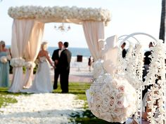 Beach wedding canopy with neutral palette