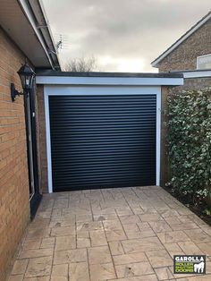 Remote controlled roller shutter garage doors are super easy to use. If you're looking for 'roller shutter garage doors near me', we have the same roller garage doors prices fitted UK wide. Black Garage Doors, Garage Doors Prices, Black Doors, Roller Doors, Roller Shutters, Black Garden, Shutter Doors, Tiffany Jones, Remote