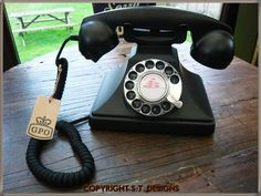 If i can't get an original version, i love this with dial (not push buttons) and bell ring.