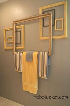 re-purpose picture frames to towel rack / wall art