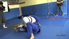 Clark Gracie demonstrates an armbar/bow and arrow choke/omoplata series from the bottom of half guard. Notice his deep grip on the lapel which keeps his opponent compact.