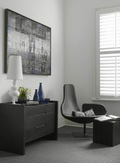 color inspiration. white walls with white/black/gray furnishings and just a touch of blue.