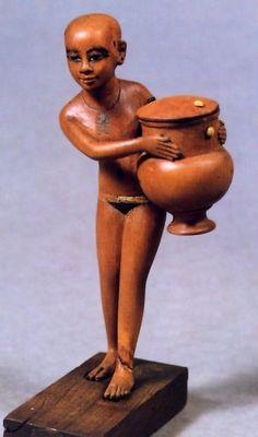 Nubian girl carrying a cosmetic jar - Egypt (c. 1350 B.C.E.)