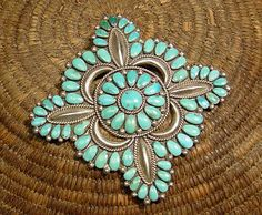 LARGE ZUNI PETIT PIN 1970'S  Floral shape Morenci turquoise petit point clustern sterling silver.