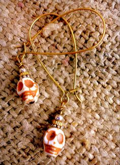 Tiny Bone Color Day of the Dead Skull earrings by CslayerD on Etsy, $7.99