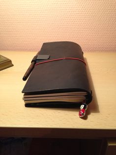 Midori travelers notebook with 3 refills and a zipper refill
