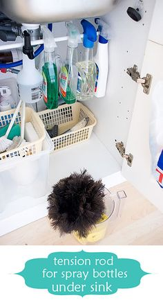 Kitchen organization ideas. this one: curtain tension rod under sink to hold spray bottles.