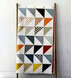 In This Corner-quilt pattern to use up scraps. So cute.