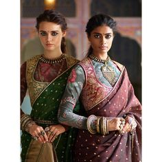 Ladies in earth-toned Varanasi organza sarees, block printed 'kanthi' blouses and 'tilla' embroidered miniature gilets. All jewellery from the Sabyasachi archives. Sari Blouse Designs, Fancy Blouse Designs, Indian Attire, Indian Wear, Indian Style, Indian Designer Outfits, Designer Dresses, Indian Designers, Indian Dresses
