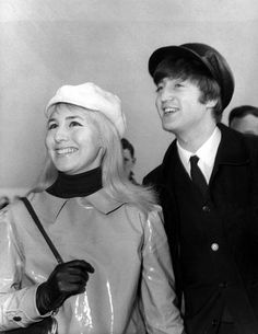 UNITED KINGDOM - FEBRUARY 07: Photo of John LENNON and Cynthia LENNON; while in The Beatles, posed with his wife Cynthia (wearing plastic mac) at Heathrow Airport (Photo by Cummings Archives/Redferns)