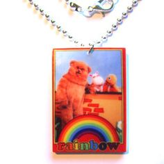 Classic Rainbow TV Inspired Acrylic pendant Necklace. Remember Bungle, George, Zippy and Geoffrey? With Rod, Jane and Freddie? Then you might just love this! Classic rainbow TV series inspired pendant necklace, printed on 3mm acrylic, on 45cm silver tone ball chain with lobster clasp fastening. (Other chain options available, please ask.)  #jewellery #jewelry #boutique #costume #kitsch #quirky #tv #childrens #series #rainbow #bungle #george #zippy #rodjaneandfreddy #acrylic #chain #necklace…