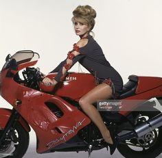British actress Joanna Lumley astride a red Triumph Daytona motorcycle, wearing a grey dress decorated with rips, chains and artificial red flowers, circa Get premium, high resolution news photos at Getty Images English Actresses, British Actresses, Nylons, Moto Scooter, Joanna Lumley, Actrices Sexy, Motorbike Girl, New Avengers, Triumph Motorcycles