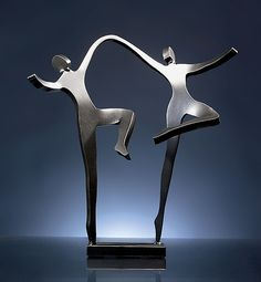 A couple dances with great delight to celebrate their bond of love. This sculpture is hand cut by the artist from steel with a rich, dark gray surface. Simple yet evocative, it uses flowing lines and an open, airy composition to convey a sense of joyful companionship. Joyous Dancers created by artist Boris Kramer: available at www.artfulhome.com