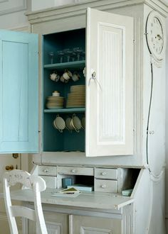 Turquoise cabinet.  I don't think the hubby could begrudge me this.  It would just be my little secret that made me smile all day long!