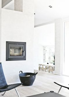 This fireplace has been mounted into the wall so that is sits flush with the wall.