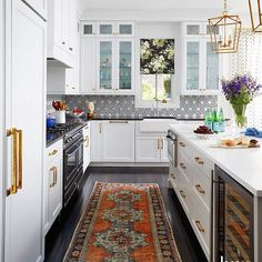 Neo-Traditional Decor & Design - Neo-traditional Kitchen Decor with Oriental Rug via Pamela Jaccarino Design by Summer Thornton. Traditional Interior, Neo Traditional, Traditional Kitchen, Traditional Decorating, Black And White Backsplash, White Kitchen Backsplash, Backsplash Ideas, Backsplash Tile, Kitchen White