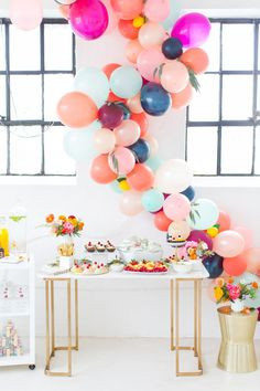 Gold and white furniture accented with balloon decoration for a fun spring soirée