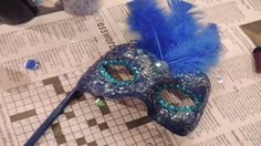 DIY masquerade mask on a stick