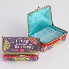 Live Love Laugh & Be Happy Day Of The Week Pill Box  -  individual pill containers in a purse, print fabric with saying/verse.  good for travel, prn meds, unique.  site has cute, fun, hippie, boho, young stuff.        lj