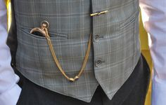 pocket watch & straight chain (with t-bar), worn from vest buttonhole to vest pocket, featuring slides along the chain length