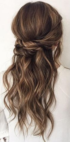 Noticed more half up hairstyles when hitting the wedding circuit?  Me too. Partial updos like this give you a sexy long mane along with a polished vibe wearing hair up brings.  For more easy answers to half up half down hair quandaries turn to TerrificTresses.com.
