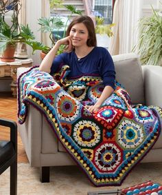 Fun, colorful, and unique are words that will immediately pop into your head when looking at this gorgeous crochet blanket pattern for the I Love Color Crochet Afghan.