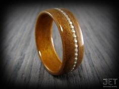 Hey, I found this really awesome Etsy listing at https://www.etsy.com/listing/150982176/walnut-bentwood-ring-with-half-bead