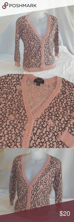 Forever 21 Hello Kitty Sweater Cardigan Size S/P Up for your consideration here, is a gently worn sweater cardigan made by Forever 21 for Hello Kitty in a size S/P. The colors are peach and black. This sweater cardigan is in great condition with no pilling. Make sure to browse my closet and add another item along with this one to receive 10% off :-) remember bundling saves you money :-) Forever 21 Sweaters Cardigans