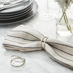 Two rings of recycled brass with a soft silver fashion a simple, organic napkin ring.