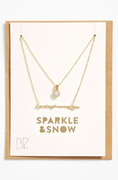 Dainty gold charm necklace.