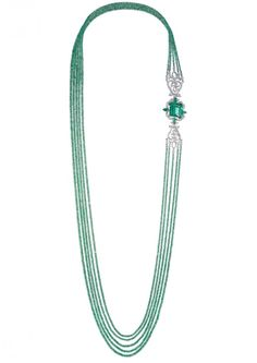 An exquisite emerald and diamond sautoir from the Red Carpet Collection. The luminous emerald-cut Colombian emerald weighing 25 carats within an opulent diamond-set lace surround, to the emerald bead sautoir.