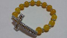 Mustard glass beads with studded cross
