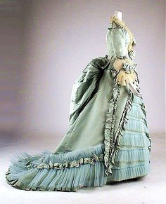 Here is another stunning 1870s bustle gown.