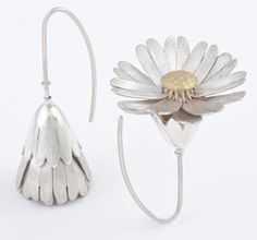 Victoria Walker - Daisy locket earrings in silver and 18 carat gold, the petals unfold to reveal gold centres