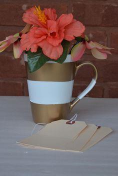 Make gold stripes on a white mug.  www.reservationsforfive.com