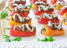 Mini Taco Stuffed Peppers - mini bell peppers stuffed with taco meat and drizzled with a cilantro cream sauce. {The Girl Who Ate Everything. Use homemade taco seasoning. Can stuff zucchini or mushrooms as well Low Carb Stuffed Peppers, Stuffed Mini Peppers, Low Carb Tacos, Low Carb Recipes, Cooking Recipes, Diet Recipes, Mini Tacos, Flautas, Snacks Für Party