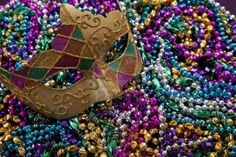 The history behind the Mardi Gras bead toss. It wasn't always about drunken women flashing their goods.
