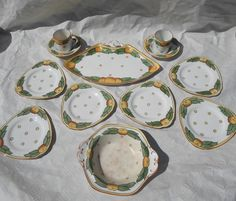 A Burleigh Ware sandwich set, designed by Charlotte Rhead in the 4105 Garland pattern, comp The Saleroom, Coffee Cans, 1920s, Sauces, Garland, Tube, Charlotte, September, Dish