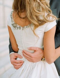 Subtle touches of ruffles, jewels, pearls + buttons.just look at these pretty trimmings! {Photo credits: 1 Bijou-Minou 2 Austin Warnock via Style Me Pretty 3 BHLDN 4 Twigs & Honey 5 Meredith Perdue via Style Me Pretty via Dust Jacket. Mini Wedding Dresses, Wedding Dress Trends, Wedding Gowns, Modest Wedding, Short Sleeved Wedding Dress, Wedding Parties, Elegant Wedding, Rever Mariage, Perfect Wedding