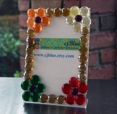 Flower Power Glass Gem Embellished Clear Acrylic Frame by cjBlue, $12.00