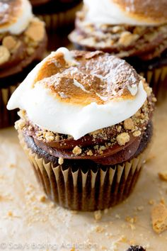 Marshmallow-Filled S'mores Cupcakes stuffed with a creamy marshmallow filling, topped with milk chocolate frosting, crushed graham crackers and a toasted marshmallow. S'mores have never tasted so good! cupcake #recipes http://thecupcakedailyblog.com/marshmallow-filled-s-mores-cupcakes/