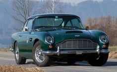 Classic Aston Martin DB5 in British racing green. My name is Code, XecretCode...