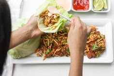 Spice it up and make copycat szechuan chicken lettuce wraps with spicy mayo from the comfort Easy Healthy Recipes, Asian Recipes, Healthy Snacks, Ethnic Recipes, Cat Recipes, Recipies, Lettuce Wrap Recipes, Chicken Lettuce Wraps, Szechuan Chicken