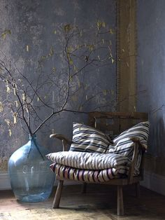 Love this large jar & hazel catkin branches for the hall next to the chair.