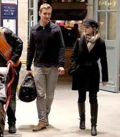 Emma Watson arrives in Paris in a chic baker boy hat and knee-high leather boots. aaaand im pretty sure this is also Luke, Tom Hiddleston's publicist