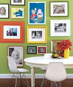 Hanging photos of your kids along with their framed artwork.