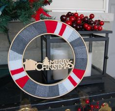 DIY Christmas Wreath - I made an upcycled wreath using work socks, felt and embroidery hoops. - northstory.ca #wreaths #christmascrafts #upcycle