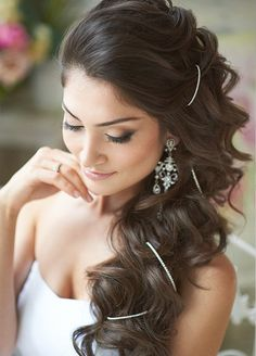 A touch of sparkle is a simple addition that's sure to dazzle your guests. Check out other 14 fabulous wedding hairstyles.