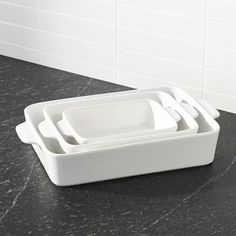 Shop White Baking Dish Set of You'll turn to our clean, white baking dishes time and again for daily meals and potluck dinner parties. Nesting stoneware bakers transition easily from oven to table. Kitchen Dishes, Kitchen Gadgets, Kitchen Stuff, Kitchen Utensils, Baking Set, Baking Dishes, Glass Baking Dish, Potluck Dinner Party, Kitchen Necessities