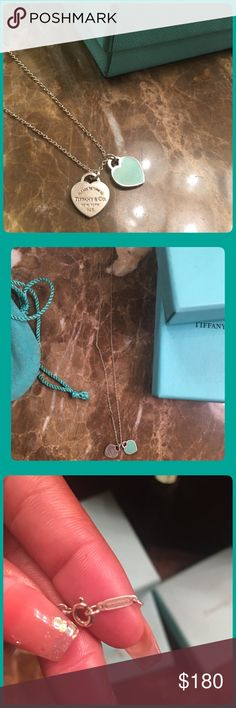 Authentic Tiffany & Co Necklace Tiffany & Co Necklace. All Sterling Silver. Blue Heart Pendant, and Silver Heart Pendant. Beautiful necklace, just needs a little polishing. Will come in original box. Tiffany & Co. Jewelry Necklaces
